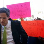 Parents protesting Marshall Tuck for closing language programs. Photo by Ron Gochez.